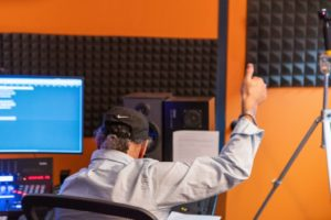 "Writer/Producer, Jeff Mustard, gives thumbs up to vocal artists in studio recording songs he wrote and produced for his TV Series, ""Boycott"" & B'Way Show."