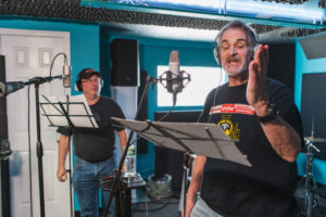 """Actors/Singers, Dave Corey (front), and Avi Hoffman, in studio recording song for Tv Show Creator, writer/Producer, Jeff Mustard, for his musical show, """"Boycott."""""""